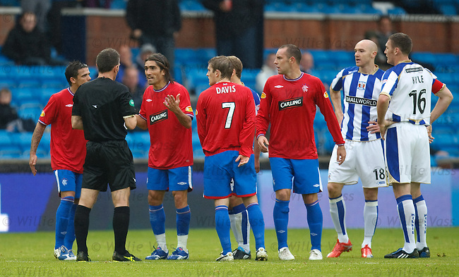 Pedro Mendes about to be sent off by ref Steve Conroy for a second yellow card offence