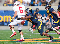 October 20th, 2012: California's Avery Sebastian rips the ball out of Stanford's Josh Nunes during a game at Memorial Stadium at Berkeley, Ca   Stanford defeated California 21 - 3