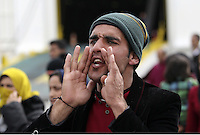 Pictured: An Afghan man protesting Tuesday 08 March 2016<br /> Re: Afghan migrants hold a protest at Piraeus port, near Athens, Greece.