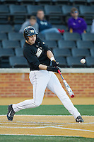 Matt Conway (25) of the Wake Forest Demon Deacons makes contact with the baseball against the Missouri Tigers at Wake Forest Baseball Park on February 22, 2014 in Winston-Salem, North Carolina.  The Demon Deacons defeated the Tigers 1-0.  (Brian Westerholt/Four Seam Images)