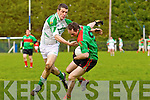 Declan Bambury of Beal shakes off the tackle of Danny Mahoney of Ballydonoghue in the Division 4/5 play off in Ballylongford GAA grounds last Sunday
