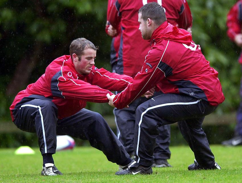 Photo. Richard Lane. .England Squad Training at Pennyhill Hotel, Bagshot.. 06-11-2002.James Simpson-Daniel and Mark Regan go through their paces.