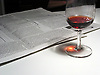 evening newspaper and glass of red wine<br /> <br /> periodico y vaso de vino tinto<br /> <br /> Abendzeitung und Rotweinglas<br /> <br /> 2048 x 1534 px