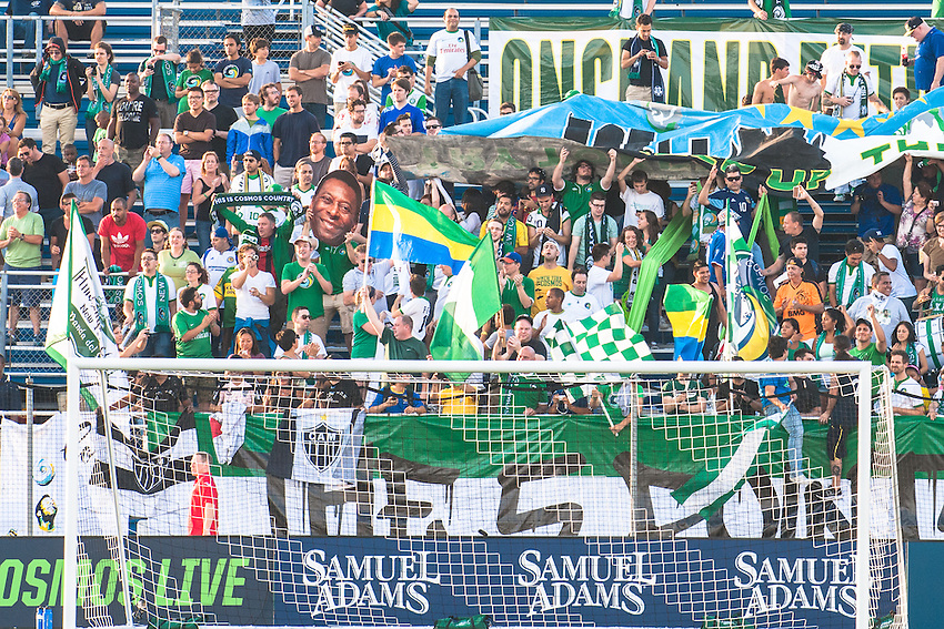 HEMPSTEAD, NY - AUGUST 3: Supporters of the New York Cosmos cheer before the start of the Cosmos' home opener against the Fort Lauderdale Strikers on August 3, 2013 at Hofstra University's Shuart Stadium in Hempstead, NY.