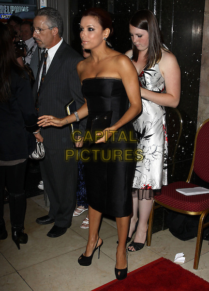 "EVA LONGORIA PARKER.Broadway Musical Los Angeles premiere Of  ""In the Heights"" held at The Pantages Theatre, Hollywood, CA, USA..June 23rd, 2010.full length black dress strapless peep toe shoes clutch bag side hands arms funny stylist adjusting .CAP/ADM/KB.©Kevan Brooks/AdMedia/Capital Pictures."