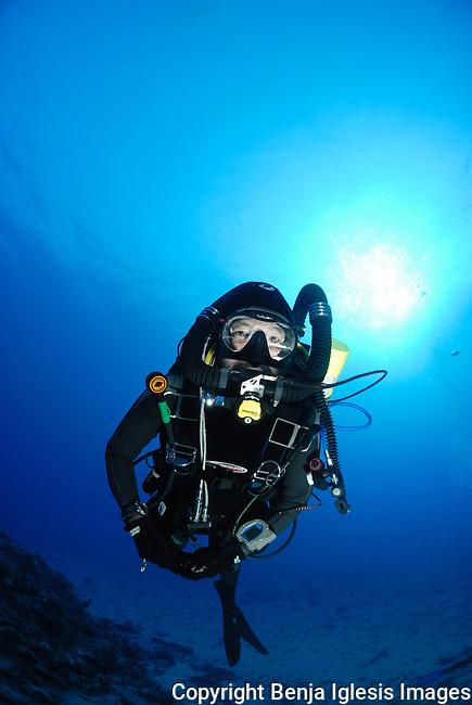 Tek diver at the 85 foot pinnacle on a rebreather Maui hawaii
