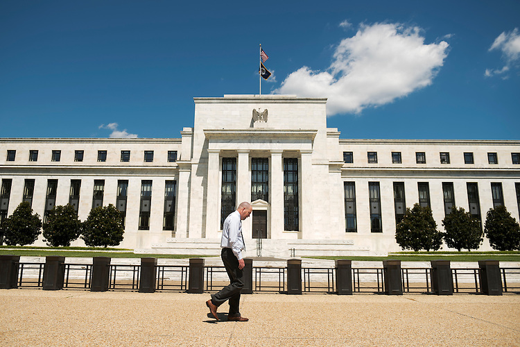UNITED STATES - AUGUST 23: A man walks by the Marriner S. Eccles Federal Reserve Board Building on Constitution Avenue, NW, August 23, 2016. (Photo By Tom Williams/CQ Roll Call)