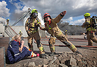 Firefighters rescue &quot;victims&quot; and put out fire in an oil facility. HarbourEx15, a field training exercise with scenarios connected to operations in the harbor April 27th &ndash; 29th 2015.<br />
