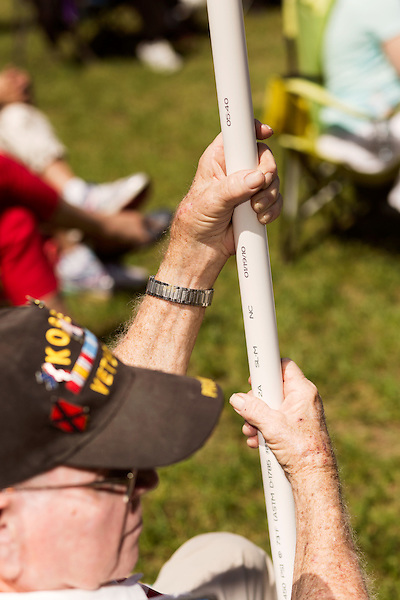 April 25, 2016. Raleigh, North Carolina. <br /> 2 tour Korean War veteran Herbert Hoover Rosser holds fast to his flagpole.<br />   Supports of House Bill 2 (HB2) held a rally that brought thousands to the Halifax Mall to show their support for the bill that has proved to be highly divisive in the state. Stating that the bill, which stated that transgender people must use the bathroom of the sex stated on their birth certificate, was a safety issue, as well as a religious moral one, a series of state politicians and religious leaders tooth stage to express their support for embattles NC governor Pat McCrory.