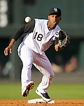 Colorado Rockies' second baseman Jonathan Herrera (18) receives a throw to turn a double play against the San Francisco Giants in a game at Coors Field in Denver, Colorado on July 1, 2010.  (Photo by Bob Campbell)