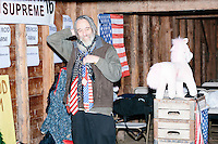 Satirical presidential candidate Vermin Supreme puts on neckties before delivering a stump speech at Ten Rod Farm in Rochester, New Hampshire. Supreme's platform advocates a pony-based economy, using zombies to solve the energy crisis, and other outlandish ideas. Supreme has been on the New Hampshire primary ballot in 2008 and 2012, though he began running for president in 1992. Vermin Supreme will be on the Democratic party ballot in the 2016 New Hampshire primary.