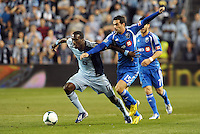 C. J Sapong Kansas City forward gets past Montreal midfielder Andres Romero..Sporting Kansas City defeated Montreal Impact 2-0 at Sporting Park, Kansas City, Kansas.