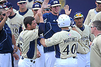 18 March 2012:  FIU's team celebrates Mike Martinez (40) breaking Tyler Townsend's career RBI record as the Florida Atlantic University Owls defeated the FIU Golden Panthers, 9-3, at University Park in Miami, Florida.