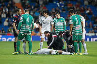 Real Madrid´s medical services assist Sami Khedira after getting injured during Spanish King Cup match between Real Madrid and Cornella at Santiago Bernabeu stadium in Madrid, Spain. May 26, 2013. (ALTERPHOTOS/Victor Blanco)