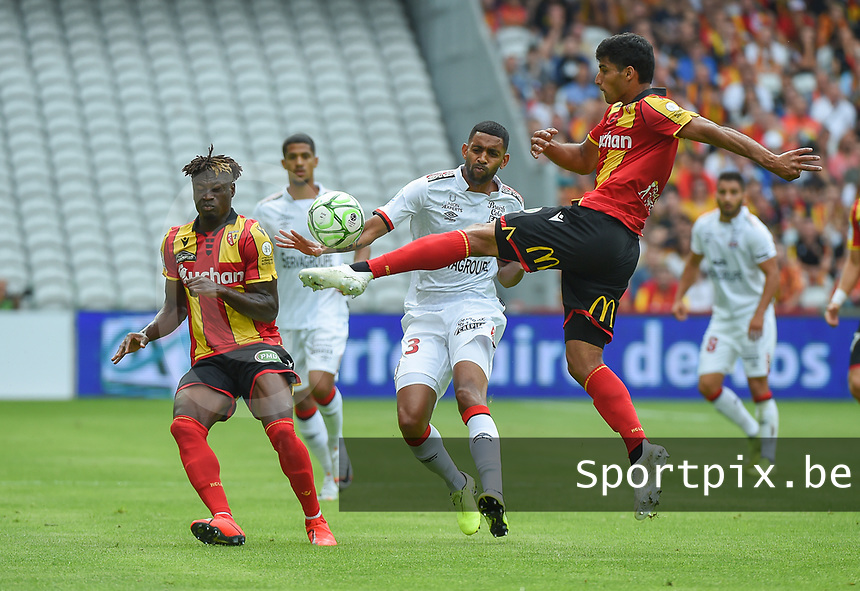 20190803 - LENS , FRANCE : Lens' Seif Touka (R) and Arial Mendy (L) with guingamp's Morgan Poaty (M) pictured during the soccer match between Racing Club de LENS and En Avant Guingamp , on the second matchday in the French Dominos pizza Ligue 2 at the Stade Bollaert Delelis stadium , Lens . Saturday 3 th August 2019 . PHOTO DIRK VUYLSTEKE | SPORTPIX.BE