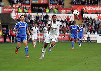 Sunday, 13 April 2014<br /> Pictured: David Ngog of Swansea (R) heads the ball forward.<br /> Re: Barclay's Premier League, Swansea City FC v Chelsea at the Liberty Stadium, south Wales,