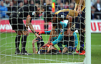 Hector Bellerin of Arsenal is injured on the ground, seen to by team mate Petr Cech and referee Kevin Friend during the Barclays Premier League match between Swansea City and Arsenal at the Liberty Stadium, Swansea on October 31st 2015