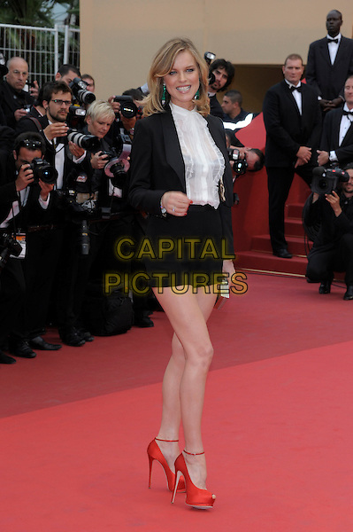 EVA HERZIGOVA. 'La Conquete' premiere at the Palais des Festivals, 64th International Cannes Film Festival, France.18th May 2011..full length black jacket white shirt red peep toe shoes ankle strap sheer blouse see thru through bra silver  clutch bag .CAP/PL.©Phil Loftus/Capital Pictures.