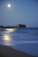 Moon rise over the ocean on the island of Kauai, Hawaii.