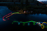 World champion squirt boater, and new women's mystery move record holder Claire O'Hara works on her mystery moves at night on the Truckee River near Reno, Nevada just prior to the world mystery move championships. This concept shoot using glowsticks attached to the athletes squirtboats is designed to show the underwater trajectory and flow of this unique form of kayaking.