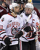 Justin Daniels (NU - 11), Tyler McNeely (NU - 94) - The Northeastern University Huskies defeated the Boston College Eagles 3-2 on Friday, February 19, 2010, at Matthews Arena in Boston, Massachusetts.