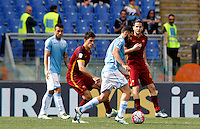 Calcio, Serie A: Lazio vs Roma. Roma, stadio Olimpico, 3 aprile 2016.<br /> Lazio's Antonio Candreva, second from right, kicks the ball during the Italian Serie A football match between Lazio and Roma at Rome's Olympic stadium, 3 April 2016.<br /> UPDATE IMAGES PRESS/Riccardo De Luca