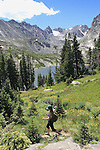 Woman hiking in the Indian Peaks Wilderness Area, west of Boulder, Colorado. Guided photo tours to Indian Peaks.