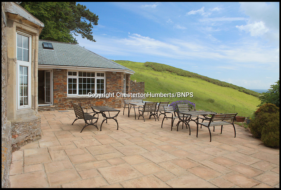 BNPS.co.uk (01202) 558833<br /> Picture: ChestertonHumberts<br /> <br /> Front patio by the kitchen<br /> <br /> The chance to become a homeowner, farmer, businessman, country squire and beach bum all in one go has arisen after a unique coastal property went on the market. Widmouth Farm Ilfracombe, North Devon, comes with a luxury house, 11 holiday cottages, sheep farm, 35 acres of cliff-top land its very own private beach. The coastal backdrop situated on Devon's rugged north coast, was immortalised in Five on a Treasure Island, the 1995 TV adaptation of Enid Blyton's first Famous Five novel.