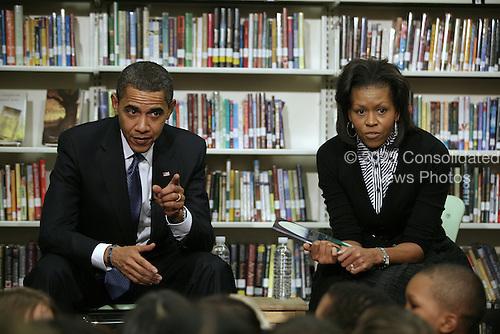 """Washington, DC - February 3, 2009 -- United States President Barack Obama and First Lady Michelle Obama made a visit to the Capitial City Public Charter School to visit with the 2nd Grade Class and read the book """"The Moon Over Star"""" to them.  .Credit: Gary Fabiano - Pool via CNP"""