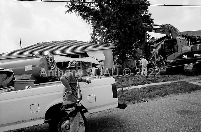 Saint Bernards Parish, Louisiana.May 26, 2006..Demolition teams work at leveling as many as 6,000 homes in St. Bernard's Parish damaged by hurricane Katrina in August of 2005...FEMA is offering to destroy home for free up until June 30, 2006. About 12 homes are being demolished a day so far. On the sight there are monitors monitoring monitors.