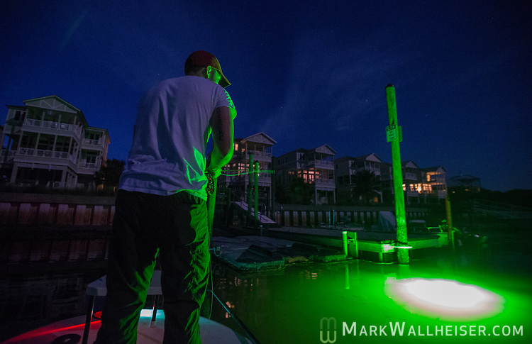 Michael Tolbert fishes dock lights at Shell Point with Justin Wallheiser.