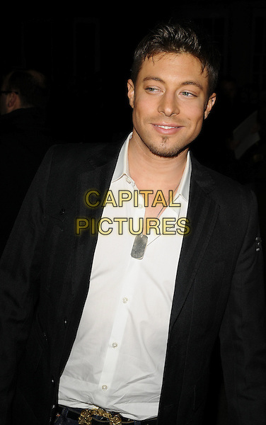DUNCAN JAMES.The Universal Music Brit Awards 2009 Afterparty, Claridge's Hotel, Brook St., London, England..February 18th, 2009.brits half length black suit jacket white shirt silver tag necklace goatee facial half .CAP/CAN.©Can Nguyen/Capital Pictures.
