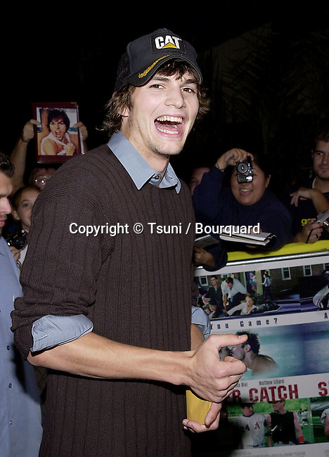 Ashton Kutcher arriving at the premiere of Summer Catch at the Mann Village Theatre in Los Angeles. August 22, 2001.           -            KutcherAshton02.jpg
