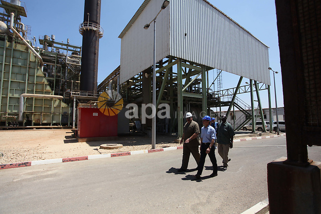 James Rawley, United Nations' humanitarian coordinator for the Palestinian territories visits a power plant supplying electricity to the Gaza Strip that was damaged due to the Israel-Hamas conflict on August 11, 2014 in Gaza City. Rawley told AFP in an interview that the international community had failed during more than a month of fighting between Israel and Hamas, which has killed more than 1,930 Palestinians and 67 people on the Israeli side. Photo by Ashraf Amra
