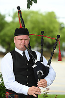 Devin Topf ((CQ)) of Fayetteville plays bagpipes Tuesday May 19, 2020 on Dickson St. in Fayetteville. Topf learned how to play the pipes through the Ozark Highlanders Pipe Band and plays private functions like weddings and funerals.  His pipe music can be found across popular social media platforms by searching for his name. Visit nwaonline.com/200520Daily/ for photo galleries. (NWA Democrat-Gazette/J.T. Wampler)