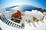 Fisheye view of whitewashed houses and caldera in Imerovigli, Santorini, Greece