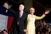 John McCain, U.S. senator from Arizona and 2008 Republican presidential candidate, and his wife Cindy Hensley McCain wave to a crowd during a Watch Party in Dallas, Texas, U.S., on Tuesday, March 4, 2008. McCain won the nomination for the Republican party on Tuesday. Photographer: Matt Nager/Bloomberg News