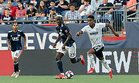 FOXBOROUGH, MA - JUNE 26: Sergio Santos #17 dribbles at midfield asWilfried Zahibo #23 closes during a game between Philadelphia Union and New England Revolution at Gillette Stadium on June 26, 2019 in Foxborough, Massachusetts.