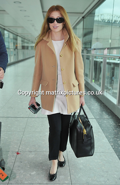 NON EXCLUSIVE PICTURE: MATRIXPICTURES.CO.UK<br /> PLEASE CREDIT ALL USES<br /> <br /> WORLD RIGHTS<br /> <br /> English recording artist and former Girls Aloud member, Nicola Roberts is pictured as she arrives at London Heathrow Airport, after a flight from Los Angeles.<br /> <br /> The 28 year old looks casual in a loose white top. <br /> <br /> NOVEMBER 5th 2013<br /> <br /> REF: STD 137170
