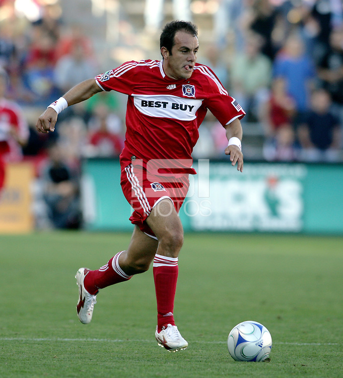 Chicago Fire midfielder Cuauhtemoc Blanco (10) dribbles the ball down the field.  The Chicago Fire defeated the Colorado Rapids 3-2 at Toyota Park in Bridgeview, IL on August 23, 2009.