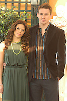 """JENNA DEWAN & CHANNING TATUM .Photocall for """"Stp Up"""", Hotel Eden, Rome, Italy..December 15th, 2006.half length dress green necklace brown suit jacket.CAP/CAV.©Luca Cavallari/Capital Pictures"""