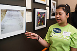 "WATERBURY, CT- 18 May 2016-051816EC09-  Kennedy High School student Kaitlyn Giron talks about her photo at Waterbury's Mattatuck Museum Wednesday night for an exhibit put on by young people. ""Picture of Health: A Youth Perspective"" is a look at issues that affect the community. Homelessness, mental health and nutrition are among the issues addressed in the students' photography projects. Giron took a picture of a common McDonald's receipt, to depict how food many people take for granted is not affordable to all Americans. Erin Covey Republican-American"