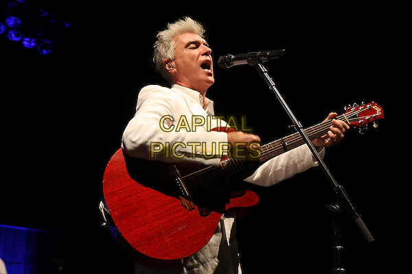 DAVID BYRNE.Live at the Royal Festival Hall, London, england..April 12th, 2009.stage concert gig performance music half length white suit guitar singing jacket .CAP/MAR.© Martin Harris/Capital Pictures.
