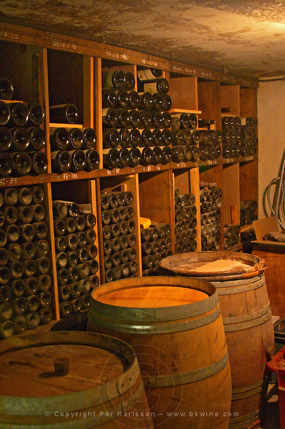 Old wine bottles aging in the wine cellar.  Alain Voge, Cornas, Ardeche, Ardèche, France, Europe