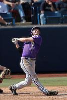 Brett Johnson #7 of the TCU Horned Frogs bats against the Cal State Fullerton Titans at Goodwin Field on February 26, 2012 in Fullerton,California. Fullerton defeated TCU 11-10.(Larry Goren/Four Seam Images)