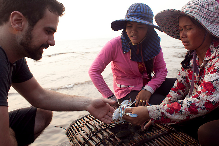 Women sell crabs at the crab market in the resort town of Kep, Cambodia. <br /> <br /> Photos &copy; Dennis Drenner 2013.
