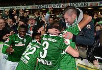 FUSSBALL   1. BUNDESLIGA   SAISON 2013/2014   11. SPIELTAG SV Werder Bremen - Hannover 96                         03.11.2013 Assani Lukimya, Oezkan Yildirim, Luca Caldirola (v.l., alle Bremen) jubeln ueber das 3:2 bei den Fans in der Ostkurve