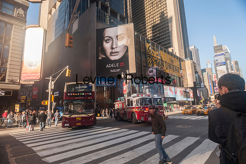 """Advertising in Times Square in New York on Friday, December 4, 2015 for Adele's new album, """"25"""". The album, released on November 20, and not available for streaming, sold a record-breaking 3.38 million copies in its first week. (© Richard B. Levine"""