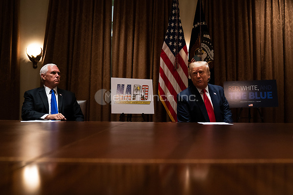 United States President Donald J. Trump, right, speaks during a meeting with members of the National Association of Police Organizations Leadership in the Cabinet Room of the White House in Washington, DC, on July 31st, 2020.<br /> Credit: Anna Moneymaker / Pool via CNP /MediaPunch