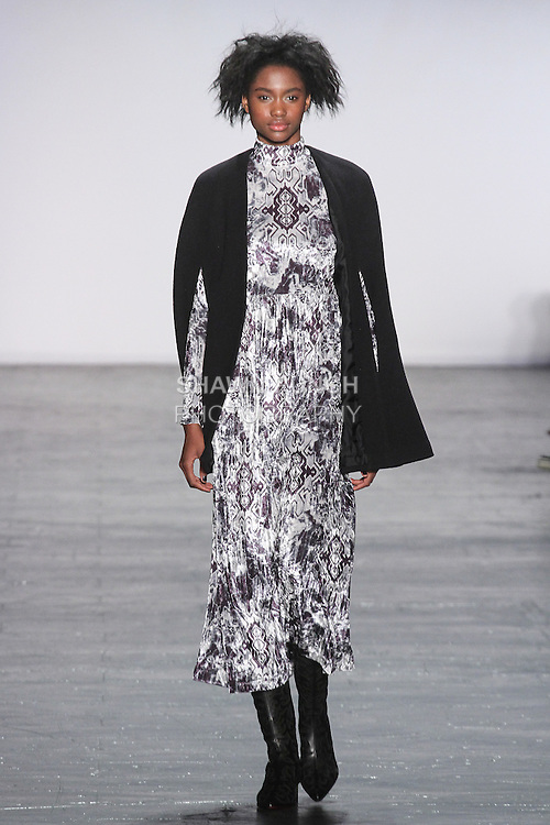 """Model Tara walks runway in a velvet Ikat mock turtleneck gown with wool cape in black, from the Vivienne Tam Fall Winter 2016 """"Cultural Dreamland The New Silk Road"""" collection, presented at NYFW: The Shows Fall 2016, during New York Fashion Week Fall 2016."""